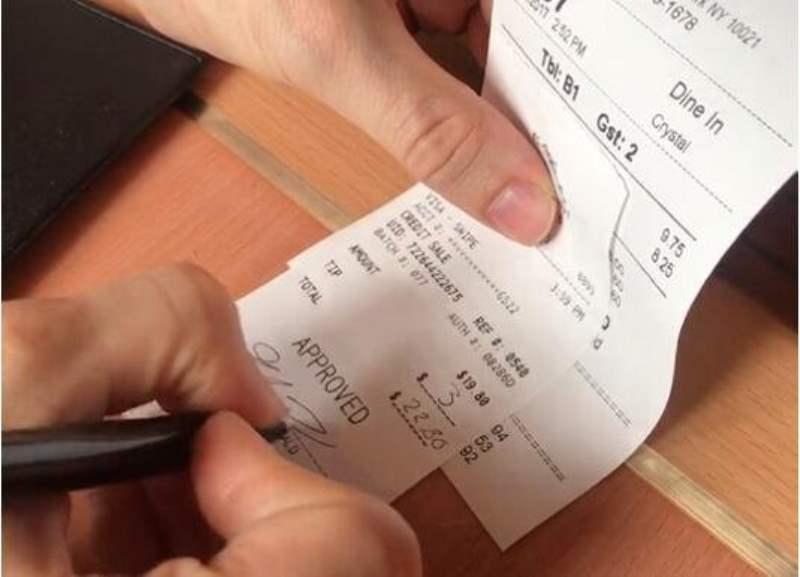 《Q. 在美国餐厅吃饭,小费怎么给?》